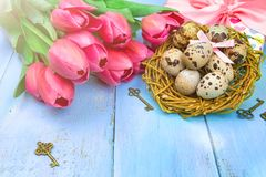 Happy Easter. Congratulatory easter background. Easter eggs and flowers. stock images
