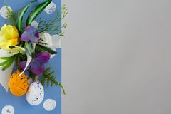 Happy Easter. Congratulatory easter background. Easter eggs and flowers stock image