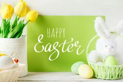 Happy Easter. Congratulatory easter background. Easter eggs and flowers.