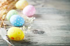 Happy Easter. Congratulatory easter background. Easter eggs and flowers. Stock Photography