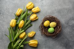 Happy Easter. Congratulatory easter background. Easter eggs and flowers stock photo