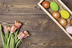 Happy Easter. Congratulatory easter background. Easter eggs and flowers stock photos