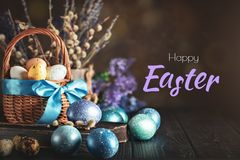 Happy Easter. Congratulatory easter background. Easter eggs and flowers. Selective focus. Horizontal royalty free stock image