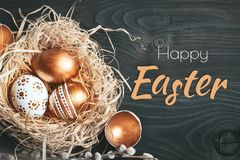 Happy Easter. Congratulatory easter background. Easter eggs and flowers. Selective focus. stock image