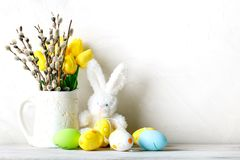 Happy Easter. Congratulatory easter background. Easter eggs and rabbit. Happy Easter. Congratulatory easter background. Background with copy space. Selective Stock Image