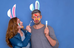Happy easter couple. Happy funny brush coloring easter couple stock images