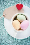 Happy Easter -  A cup of eastereggs Stock Images