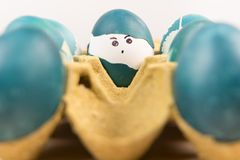 Happy easter, cute boy organic easter eggs, painting face on egg, easter holiday decorations, easter concept backgrounds. With copy space Stock Photography