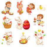 Happy Easter. Cute Easter bunny sitting in a basket, juggling with easter eggs, decorated Easter Egg. Little girl holding large chocolate egg. Boy dressed in a Stock Image
