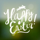 Happy easter cute cartoon calligraphy.  blurred background. Royalty Free Stock Images