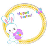 Happy Easter. Cute Easter bunny holding an egg. Stock Photo