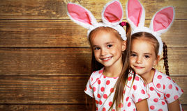 Happy easter! cute twins girls sisters dressed as rabbits  on wo Stock Images