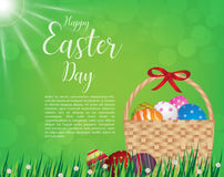 Happy easter day design Basket of easter eggs on green grass Stock Images