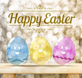 Happy Easter Day : Three Colorful Glitter transparency glass egg. With smile face on wood table with golden sparkling background Royalty Free Stock Image