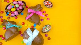 Happy Easter decadent chocolate background overhead with Easter eggs and candy. stock video footage