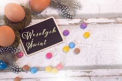 Happy easter decoration with blackboard and eggs, Wesołych Świąt royalty free stock photos