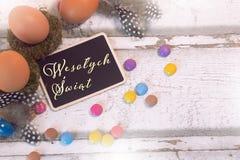 Happy easter decoration with blackboard and eggs, Wesołych Świąt royalty free stock photos