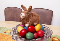 Happy Easter 2019. Decorative rabbit on eggs. The colors of the eggs are: Red, yellow, green, blue, pink stock photo