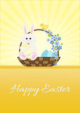 Happy Easter.Easter bunny sitting in a basket. Royalty Free Stock Images
