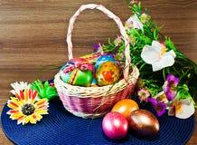 Happy Easter/ Easter eggs basket. Easter/ Easter eggs basket/ painted Easter eggs/Easter flowers Stock Image