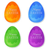 Happy Easter in easter eggs with flowers Stock Image