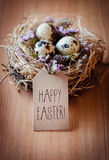 Happy Easter!. Easternest with quail eggs and greeting card Stock Photography