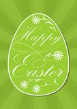 Happy easter egg with calligraphic inscription, white letters and flowers on vivid spring green, green rays on background.  Royalty Free Stock Photo