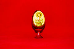 Happy Easter egg. Colorful festive easter egg on red background Stock Image