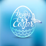 Happy Easter egg with the holiday symbol on a blue background. Stock Photography