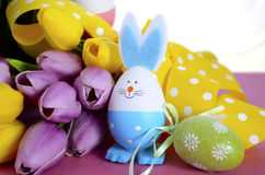 Happy Easter egg hunt baskets with bunny eggs Stock Photos