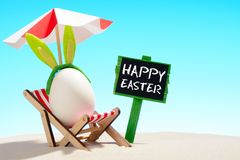 Happy Easter and egg on lounger stock photo