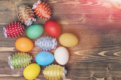 Easter colorful eggs decorated with thread, beads with willow, osier Royalty Free Stock Photography