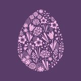 Happy easter egg silhouette filled with beautiful flowers. An isolated image of  Easter egg silhouette filled with early spring flowers such as miscarry, tulips Stock Photography