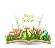 Happy easter egg spring with grass in the book Royalty Free Stock Image