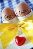 Happy Easter Eggs. Two eggs in white egg cups with an Easter message stock photography