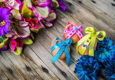 Happy Easter eggs with colored ribbons and pearls Royalty Free Stock Photo