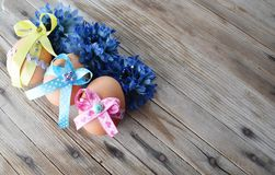 Happy Easter eggs with colored ribbons and pearls Royalty Free Stock Image