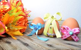 Happy Easter eggs with colored ribbons and pearls Stock Photo