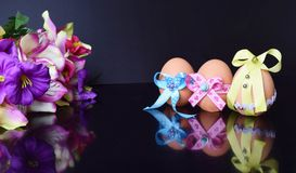 Happy Easter eggs with colored ribbons and pearls Stock Photography