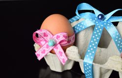 Happy Easter eggs with colored ribbons and pearls Royalty Free Stock Photography