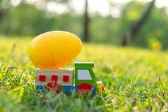 Happy Easter with  Eggs cute bunny and car in the morning, Funny decoration in grass spring season. Happy Easter with Eggs cute bunny and car in the morning royalty free stock photo