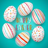 Happy Easter eggs frame with text. Colorful easter eggs on blue. hand font. Scandinavian ornaments. Royalty Free Stock Photos