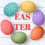 Happy Easter eggs frame with text. Colorful easter eggs on white wooden background. Your design,. Elegant ornaments.  illustration. Postcard template Stock Photos