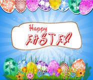 Happy Easter  with eggs in grass and Flowers Stock Image