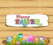 Happy Easter  with eggs in grass and Flowers Royalty Free Stock Images