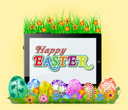 Happy Easter  with eggs in grass and Flowers Royalty Free Stock Photo
