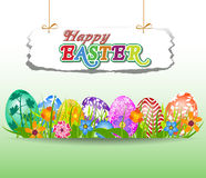 Happy Easter with eggs in grass and Flowers Royalty Free Stock Photography