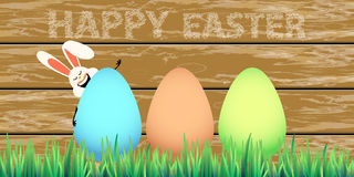 Happy easter eggs in grass with rabbit. Hungry. Illustration for your design Stock Photos