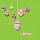 Happy easter eggs hanging on the wire background Stock Photos