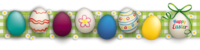 Happy Easter Eggs Header Checked Cloth. Colored easter eggs with daisy flowers on the checked table cloth Royalty Free Stock Photography